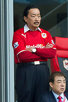 Football - 2013 / 2014 Premier League - Cardiff City vs. Crytal Palace<br /> <br /> Cardiff owner vincen tan watches from the directors' boxat the Cardiff City Stadium.<br /> <br /> COLORSPORT/WINSTON BYNORTH