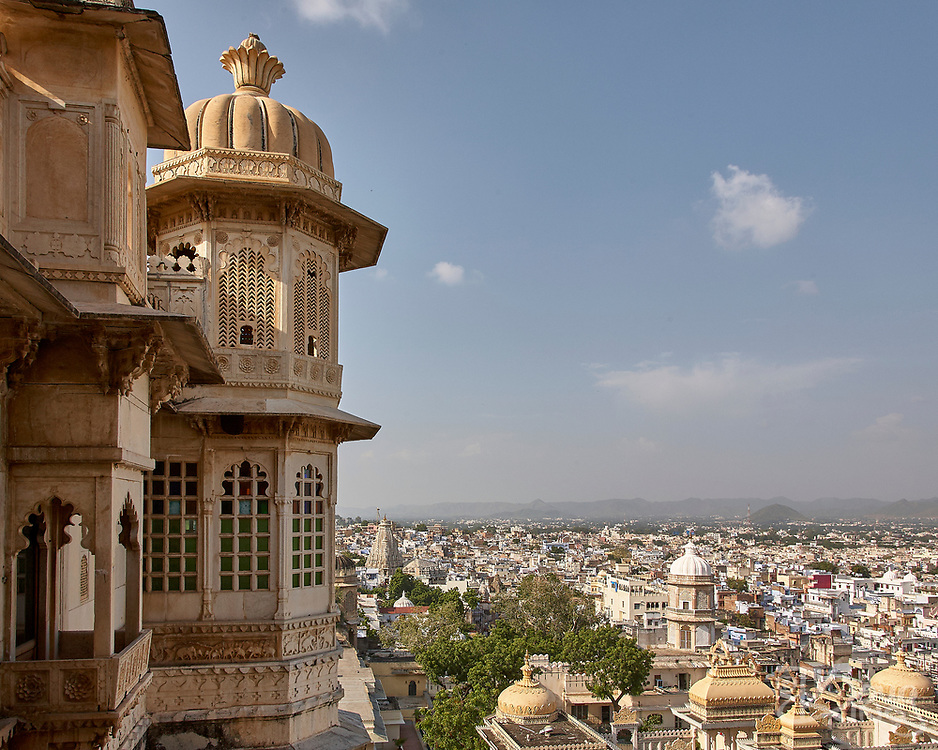 Elaborately carved turrets of the City Palace overlook the city of Udaipur, Rajasthan, India <br /> <br /> Editorial & Non-Commercial use only