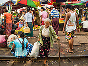 """25 OCTOBER 2015 - INSEIN, MYANMAR:  The entrance to Danyin Market (also known as Da Nyin) in Insein, Myanmar, about 90 minutes from Yangon. Vendors in the market sell just about everything people in the area need, but mostly it's a """"wet market"""" with fruits, vegetables and meats. Most people in Myanmar still do not have refrigerators in their homes, so people go to market almost every day.    PHOTO BY JACK KURTZ"""