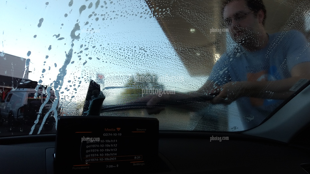 Washing the Windshield at the Exxon 19601 Queen Crown Rd, Carey, ID. On the Road in Idaho after the Total Solar Eclipse 2017.