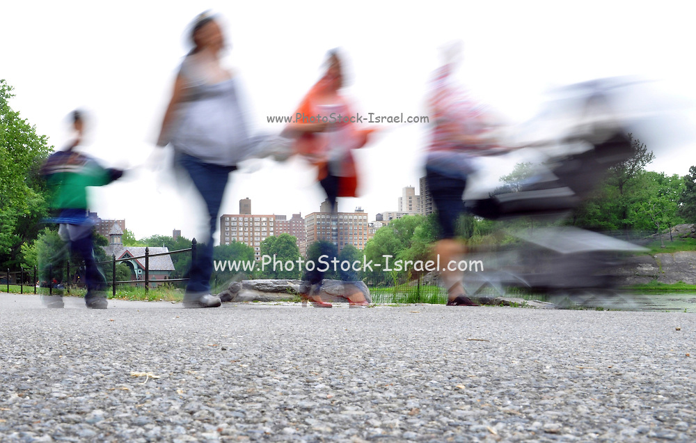 Central Park, New York City, USA people walking, motion blur