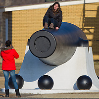 A couple of friends take a moment for a photo while atop the 20-inch Rodman gun on display in Fort Hancock part of Sandy Hook National Gateway Recreation Rea.  The cannon is the largest muzzle-loading cannon ever built in the United States.