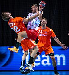 The Dutch handball player Jasper Adams, Cemal Kutahya in action during the European Championship qualifying match against Turkey in the Topsport Center Almere.