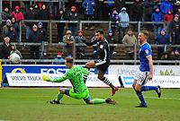 Lincoln City's Matt Green lifts the ball over Carlisle United's Jack Bonham to score the opening goal<br /> <br /> Photographer Andrew Vaughan/CameraSport<br /> <br /> The EFL Sky Bet League Two - Carlisle United v Lincoln City - Monday 2nd April 2018 - Brunton Park - Carlisle<br /> <br /> World Copyright © 2018 CameraSport. All rights reserved. 43 Linden Ave. Countesthorpe. Leicester. England. LE8 5PG - Tel: +44 (0) 116 277 4147 - admin@camerasport.com - www.camerasport.com
