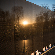 Formally known as the Vietnam Veterans Memorial, it dates to 1982-83. The centerpiece is the Vietnam Veterans Memorial Wall, long multi-piece wall made of gabbor into which are etched the names of U.S. servicemen who died or were missing in action in the Vietnam War. It was designed by Maya Lin.