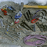 ROCK CLIMBING. Big wall climbing hardware, including carabiners, cams, chocks, pitons, hooks, slings, bashies & a hammer.