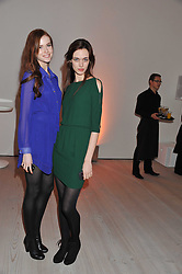 """Left to right, LAURENCE BEAUVAIS and ELLEN GIBBONS at the launch of """"Photo-Me by Starck"""" – a photobooth exclusively designed by the world renowned artist and creator Philippe Starck held at The Saatchi Gallery, Duke Of York Square, Kings Road, London on 2nd November 2011."""