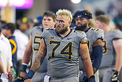 Sep 11, 2021; Morgantown, West Virginia, USA; West Virginia Mountaineers offensive lineman James Gmiter (74) walks along the sidelines during the third quarter against the Long Island Sharks at Mountaineer Field at Milan Puskar Stadium. Mandatory Credit: Ben Queen-USA TODAY Sports
