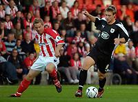 Photo: Ed Godden.<br /> Cheltenham Town v Bristol City. Carling Cup. 22/08/2006.<br /> John Finnigan (L) challenges Bristol's David Noble.