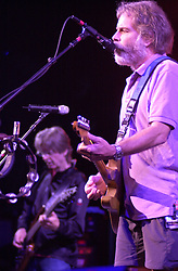 Bob Weir, with Phil Lesh in the background. The Dead in concert at the Hartford Meadows 21 June 2003