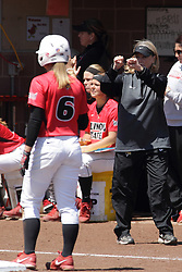 26 April 2015:   With Regan Romshek on third and another runner on 2nd, Melinda Fischer flashes signs all around during an NCAA Missouri Valley Conference (MVC) Championship series women's softball game between the Loyola Ramblers and the Illinois State Redbirds on Marian Kneer Field in Normal IL