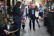 On Charing Cross Road people of different ages and very differently dressed legs pass one another in London, England, United Kingdom. (photo by Mike Kemp/In Pictures via Getty Images)