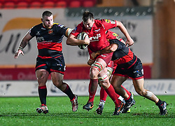 Scarlets' David Bulbring is tackled by Dragons' Liam Belcher<br /> <br /> Photographer Craig Thomas/Replay Images<br /> <br /> Guinness PRO14 Round 13 - Scarlets v Dragons - Friday 5th January 2018 - Parc Y Scarlets - Llanelli<br /> <br /> World Copyright © Replay Images . All rights reserved. info@replayimages.co.uk - http://replayimages.co.uk
