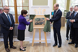© Licensed to London News Pictures . 14/09/2017 . Liverpool , UK . The Duke of Cambridge , Prince William , unviels a plaque with Mersey Care Chief Executive Joe Rafferty and Chairman Beatrice Fraenkel during a visit to Life Rooms in Walton . Life Rooms provides community support to help people recover from mental health issues . Photo credit : Joel Goodman/LNP