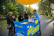 The charity 1010 campaigns for awareness of the proposed cuts to solar energy subsidies called Feed in Tariffs in Victoria Park. They hand out free ice cream, flyers and strike up conversations with a yellow ballon on a tricycle. The cuts by up 90% proposed by the UK government will put a stop on any future solar panel installations in the UK.
