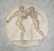 Gladiateurs. Circular relief of 2 gladiators in unarmed combat with one another.