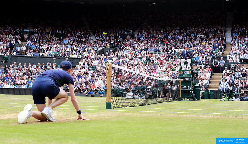 LONDON, ENGLAND - JULY 14: A general view of the Umpire and ball boy watching the ball fly over the net on Center Court during of the Wimbledon Lawn Tennis Championships at the All England Lawn Tennis and Croquet Club at Wimbledon on July 14, 2017 in London, England. (Photo by Tim Clayton/Corbis via Getty Images)