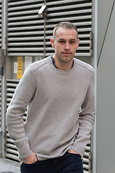 """© Licensed to London News Pictures . File picture dated 18/03/2015 of LIAM EDWARDS outside Manchester Magistrates' Court as today (23rd July 2015) Edwards has been sentenced to a four-week curfew to run between 2100 and 0700 at Manchester Magistrates' Court. Edwards was charged with Causing Racially or Religiously Aggravated Criminal Damage . On 18th February 2015 , stickers reading """" Beware! Halal is barbaric and funds terrorism """" were placed by Edwards on products and displays in Sainsbury's supermarket , on Regent Road in Salford . Photo credit : Joel Goodman/LNP"""