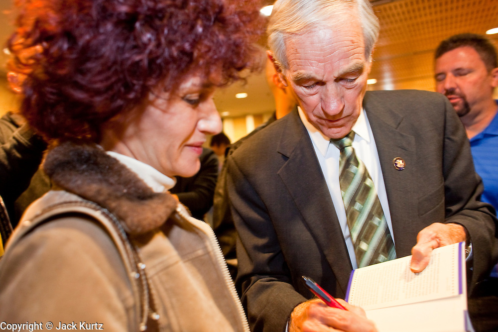 """Dec. 5, 2009 -- TEMPE, AZ: Rep. RON PAUL (R-TX) autographs his book for supporters at the Arizona Campaign for Liberty Convention in the Memorial Union building in Tempe, AZ, Saturday. Rep. Paul is in the Phoenix, AZ, area over the weekend making speeches and signing his book, """"End the Fed."""" Saturday morning he spoke at the first annual """"Arizona Campaign for Liberty Convention."""" Most of the attendees supported Rep. Paul during his run for the Republican nomination for US President in 2008.   Photo by Jack Kurtz"""