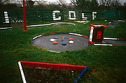 An abandoned Crazy Golf course lies broken and sad in a field at the north-western seaside resort of Southport.