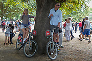 On the 100th anniversary of the Royal Air Force RAF and following a flypast of 100 aircraft formations representing Britains air defence history which flew over central London, two members of the public gain extra height on Santander rental bikes, on 10th July 2018, in London, England.