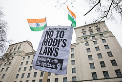 London, UK. 25 January, 2020. A placard and Indian flags at a protest by hundreds of people opposite Downing Street against Modi's government as part of a 'National demonstration against fascism in India' organised by groups including South Asia Solidarity Group, Tamil People in the UK, Kashmir Solidarity Movement, Indian Workers Association (GB) and Indian Muslim Federation(UK). Representatives of the groups spoke out against moves by the Modi government to turn India into a Brahmanical Hindu state, the Citizenship Amendment Act (CAA), the National Register of Citizens (NRC), state-sponsored violence against minorities and dissenters and colonialism with regard to Kashmir.