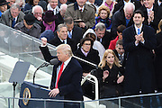 President Donald Trump holds his fist in victory to the crowd following his Inaugural address after being sworn-in as the 45th President on Capitol Hill January 20, 2017 in Washington, DC.