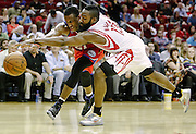 Dec 19, 2012; Houston, TX, USA; Houston Rockets shooting guard James Harden (13) and Philadelphia 76ers small forward Thaddeus Young (21) reach for a loose ball during the second quarter at the Toyota Center. Mandatory Credit: Thomas Campbell-USA TODAY Sports