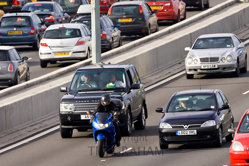 Motorcyclist in front of traffic on M25 motorway, near London, United Kingdom