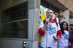 London, UK. 26th February, 2019. Petros Elia, General Secretary of United Voices of the World (UVW), addresses mainly migrant striking outsourced workers belonging to the Independent Workers of Great Britain (IWGB), UVW and Public and Commercial Services Union (PCS) trade unions working at the University of London (IWGB), Ministry of Justice (UVW) and Department for Business Energy and Industrial Strategy (PCS), together with representatives of the National Union of Rail, Maritime and Transport Workers (RMT) Regional Council, taking part in a 'Clean Up Outsourcing' demonstration to call for an end to the practice of outsourcing. The demonstration was organised to coincide with a significant High Court hearing of an application by the IWGB for judicial review of a decision by the Central Arbitration Committee (CAC) not to hear their application for trade union recognition for the purposes of collective bargaining with the University of London.