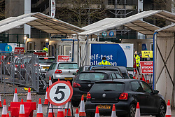 © Licensed to London News Pictures. 04/01/2021. London, UK. Queues of cars form at busy testing Centre in Twickenham, South West London as Downing Street mulls over another full national lockdown with schools already closed across the capital and parts of the South East. Today, Health Minister Matt Hancock revealed that the government is incredibly worried about the new South African strain of Covid-19 as the first person in the world is vaccinated with the Oxford AstraZeneca vaccine as over 500,000 doses are made available for vulnerable people today. Photo credit: Alex Lentati/LNP