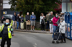 © Licensed to London News Pictures. 19/06/2021. Banstead, UK. Local residents line up at a mobile test centre at Banstead, Surrey. Surge testing for the coronavirus is taking place in parts of Surrey after a rise in infections caused by the delta variant. Photo credit: Peter Macdiarmid/LNP