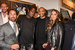 Left to right, Jay Rutland, Bradley Theodore, Thierry Henry and Andrea Rajacic at a private view of work by Bradley Theodore entitled 'The Second Coming' at the Maddox Gallery, 9 Maddox Street, London England. 19 April 2017.