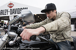Colton Weaver of Dallas, TX checking out the 2015 Harley-Davidson V-Rod 1250cc to see what his next bike to go with his Sportster will be at the Harley-Davidson display at Daytona International Speedway on the first day of Daytona Beach Bike Week 2015. FL, USA. Saturday, March 7, 2015.  Photography ©2015 Michael Lichter.