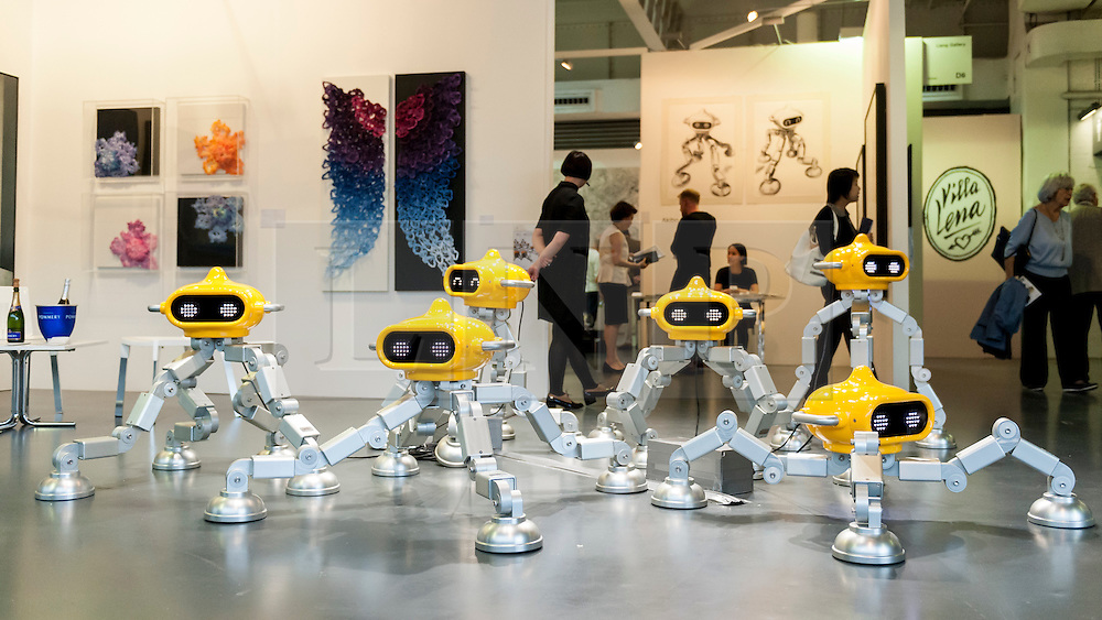 """© Licensed to London News Pictures. 19/05/2016. London, UK. Lee Ming Dao's """"Tika"""" series of robot like figures.  Art16 opens at Olympia, in west London.  Now in its fourth edition, the fair brings together over 100 galleries from more than 30 countries showcasing a diverse cross-section of work by contemporary artists from around the world for buyers and art enthusiasts to visit. Photo credit : Stephen Chung/LNP"""