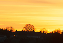 © Licensed to London News Pictures. 13/02/2019. Orpington. The sunsets over South East London tonight as Valentines day tomorrow looks set to be sunny and warm. Photo credit: Grant Falvey/LNP