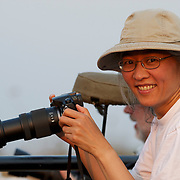 Cathy Pemberton photographing on safari in Londolozi Gamer Reserve, Sabi Sand Game Reserve, South Africa.