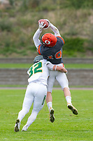 KELOWNA, BC - SEPTEMBER 22: Taylor Fleming #32 of Valley Huskers grabs Conor Richard #10 of Okanagan Sun as he catches the pass at the Apple Bowl on September 22, 2019 in Kelowna, Canada. (Photo by Marissa Baecker/Shoot the Breeze)