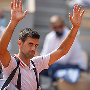 PARIS, FRANCE June 7.  Novak Djokovic of Serbia celebrates his victory against Lorenzo Musetti of Italy on Court Philippe-Chatrier during the fourth round of the singles competition at the 2021 French Open Tennis Tournament at Roland Garros on June 7th 2021 in Paris, France. (Photo by Tim Clayton/Corbis via Getty Images)
