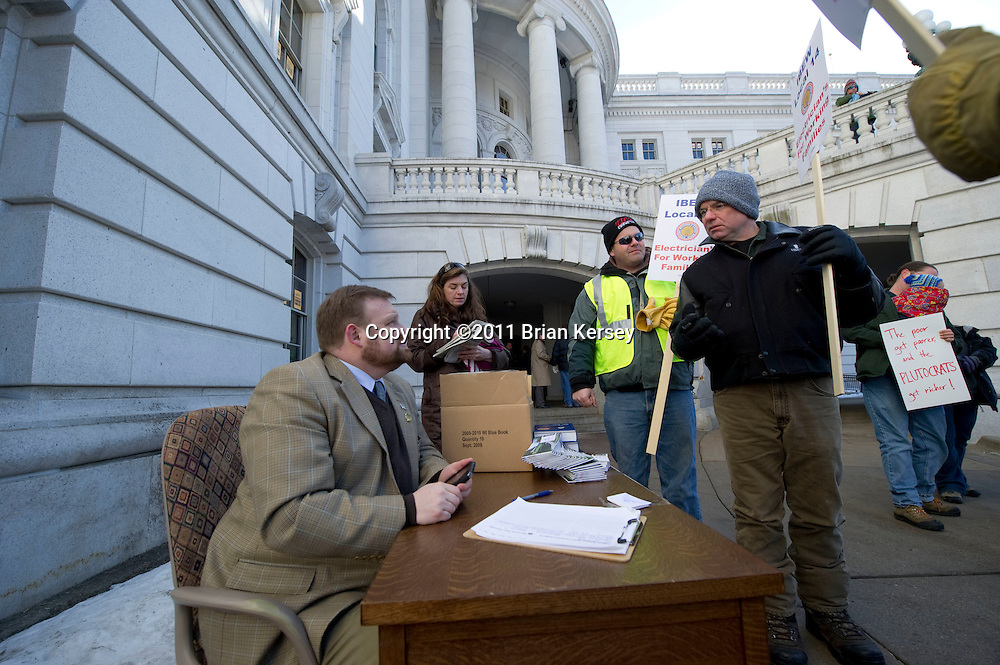 State Rep. Cory Mason sits at his desk outside of the State Capitol on March 2, 2011 in Madison, Wisconsin. Four Democratic assembly members set up offices outside the building, claiming that restrictions on entry to the state Capitol prevented the public from having sufficient access to their representatives.     (Photo by Brian Kersey)