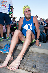 © Licensed to London News Pictures. 05/10/2016. Bristol, UK. Marathon runner BEN SMITH at the finish of his final 401st marathon, in Millennium Square in Bristol harbour side. Ben has been undertaking a 'World Record' attempt which will see him have run 401 marathons in 401 consecutive days around 309 different locations of the UK mainland. The challenge aims to raise both awareness of the issues of bullying in society along with £250,000 for two charities dedicated to tackling bullying, 'Stonewall' and 'Kidscape'. Both these charities work to support award winning initiatives which against bullying in UK schools and society in all its forms. Photo credit : Simon Chapman/LNP