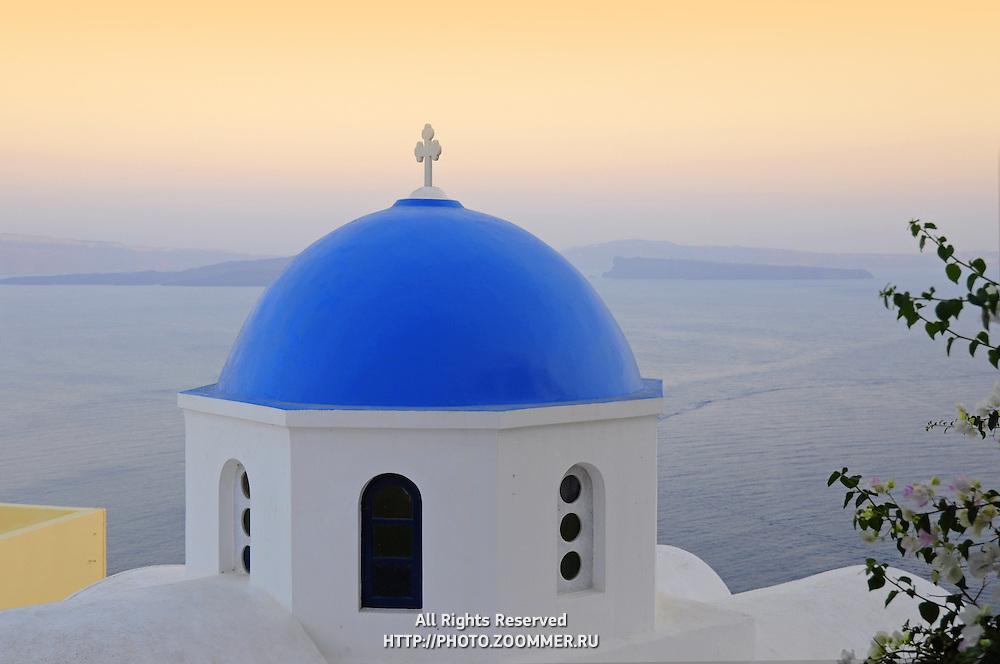 Blue dome of orthodox church in Oia town, Santorini