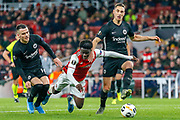 Eintracht Frankfurt midfielder Filip Kostic (10) appears to foul Arsenal midfielder Bukayo Saka (77), no penalty given, during the Europa League match between Arsenal and Eintracht Frankfurt at the Emirates Stadium, London, England on 28 November 2019.