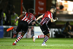 Lincoln City's Lee Frecklington (right) celebrates scoring his side's second goal of the game