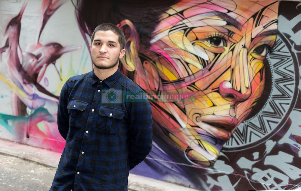 November 10, 2016 - Hong Kong, Hong Kong S.A.R, China - Wall painting by Parisian street artist Alexandre Monteiro aka Hopare (pictured)of Hong Kong actress and canto pop star Niki Chow .''Walls of Change'' street art in Hong Kong painted ahead of the The √íHope for Wildlife√ì Gala Dinner to raise awareness for the plight of endangered animals the world over..Sai Yin Pun Hong Kong.10th November 2016. Photo by Jayne Russell (Credit Image: © Jayne Russell via ZUMA Wire)