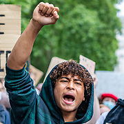 """An activist shouts """"Black Lives Matter"""" as the mass gathered protestors in Marble Arch, Central London, on Sunday, July 19, 2020 - march towards the US Embassy throughout Hyde Park. The Black Lives Matter movement invited people to continue the eighth weekend of anti-racism protests in Britain.(VXP Photo/ Vudi Xhymshiti)"""