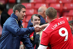 Burton Albion manager Nigel Clough shakes hands with a Manchester United fan during the Carabao Cup, Third Round match at Old Trafford, Manchester.