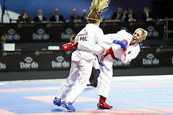 November 10, 2018 - Madrid, Madrid, Spain - German karateka Jana Bitsch (R) seen fighting with Polish karateka Dorota Banaszczyk to compete for the Gold Medal during the Kumite female -55kg competition of the 24th Karate World Championships at the WiZink centre in Madrid. (Credit Image: © Manu Reino/SOPA Images via ZUMA Wire)