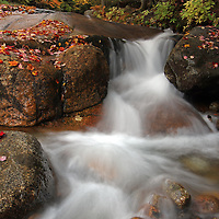 Scenic landscape photos of this beautiful New England fall foliage and flume brook long exposure photography scenery at Table Rock from the Franconia Notch State Park of the White Mountains in New Hampshire are available as museum quality photography prints, canvas prints, acrylic prints or metal prints. Prints may be framed and matted to the individual liking and decorating needs:<br />