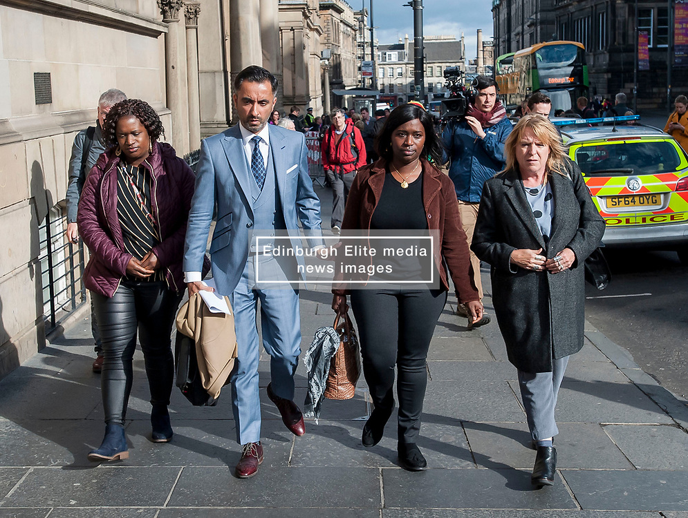 Pictured: Adama Jalloh (left) and Kadi Johnson (2nd Right), sister's of Sheku Bayoh, leave the Crown Office with lawyer Aamer Anwar and campaigner Deborah Coles (right)<br /> <br /> © Dave Johnston / EEm